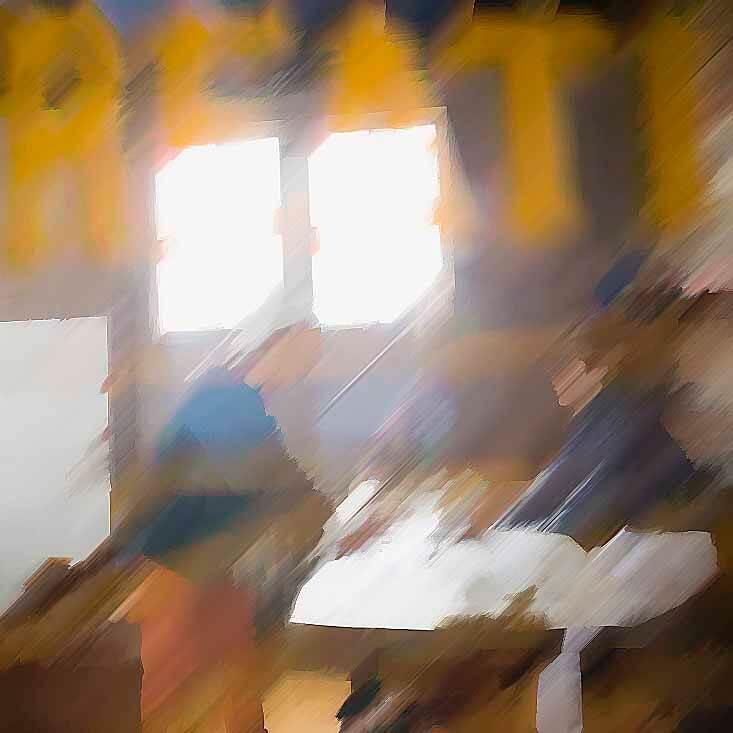 View through door of entrepreneurs working in office